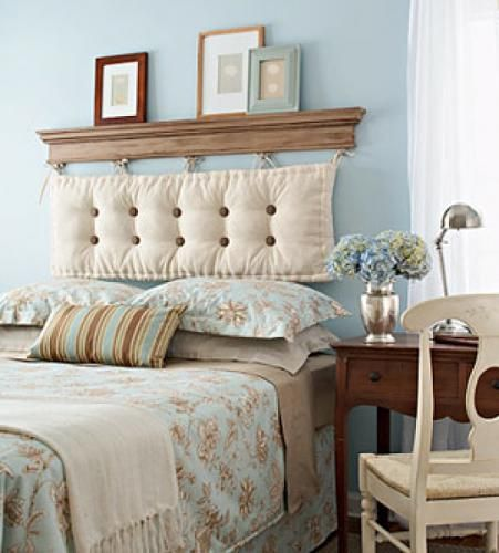 1. Hang a wood molding above the bed leaving space below to hang the cushion. 2. Apply some round metal hooks to the bottom of the molding where the cushion will hang. 3. Get a bench cushion and apply some fabric strips to tie it up. Hang it from the molding. 4. The molding serves also as a shelf.