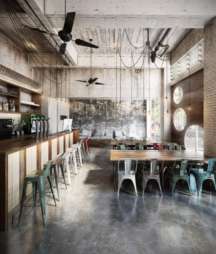 This concrete floor, these lights, this reclaimed wood counter... And this brick wall.. Love it all