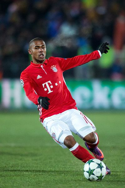 Douglas Costa #11 of FC Bayern Muenchen controls the ball during the UEFA Champions League match between FC Rostov and Bayern Muenchen at Olimp-2 on November 23, 2016 in Rostov-on-Don, Russia.