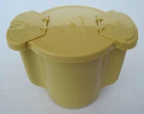 My grandma had one. Tupperware sugar bowl