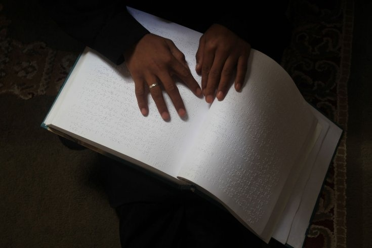 A Palestinian girl attends a class on how to read the Koran, Islam's holy book, in braille at a camp in a local mosque in Gaza City.