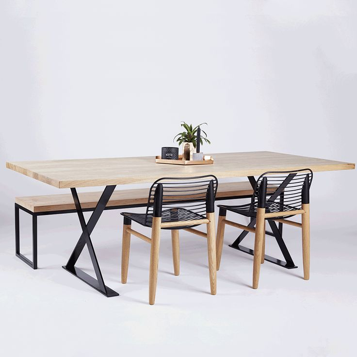 The Alexandria Dining Table is crafted with a solid American White Oak Wooden and Timber Top, with black powder coated steel metal iron legs. Featured here is the Xaria American Oak Dining Chair and Alexandria Dining Bench. All available in our online store.