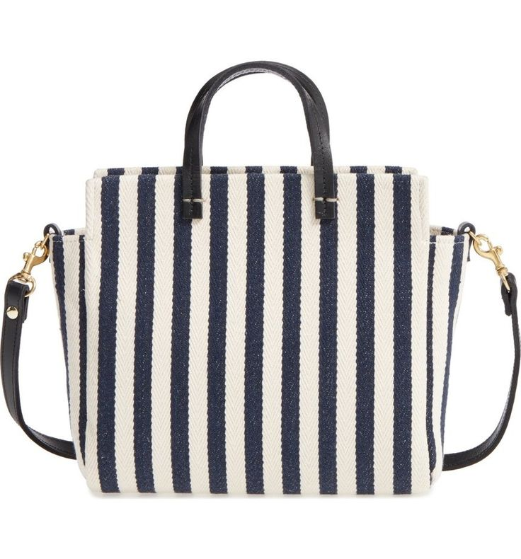 Navy stripes add flair to this compact tote furnished with a crossbody strap for hands-free carry.