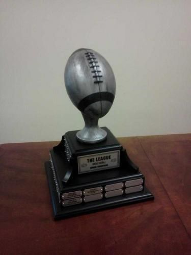 """Fantasy Football Trophy 48. This quality fantasy football trophy is made of a 14"""" square genuine walnut base, painted black, with a life-sized antique silver resin football on top.  Price includes a header plate personalized with your league name, and 48 individual silver plates for annual updates.  Fantasy Football Trophy 32 at www.rcbawards.com."""