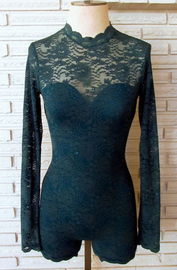 This aerial costume is constructed of a sturdy cotton/nylon/spandex lace overlay with with scalloped edges. The lining is a coordinating