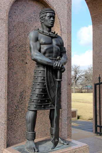 """The Sentinel"" at Freedman's Memorial represents the dignity and magnificent humanity of the African-American slave. Freedmen Memorial Cemetery - Dallas, Texas. This historic and state landmark memorial features figures cast in bronze by artist David Newton."