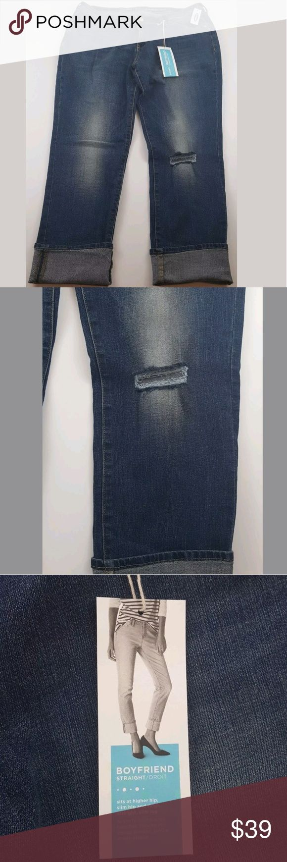 """NEW Old Navy Women's Jeans 12 Boyfriend Straight Brand: Old Navy  size: women's 12 Regular  style: Boyfriend straight (sits at higher hip, slim hip and thigh, straight & slim leg) Factory distressed, faded and destroyed  wash: med/dark blue  material:85% cotton 13% polyester 2% Spandex  condition: Brand new-no flaws- tags still attached  measurements...  waist laying flat across: 17.5""""  inseam: 29"""" un-cuffed  rise: 10""""  leg opening at ankles: 7.25"""" Old Navy Jeans Boyfriend"""