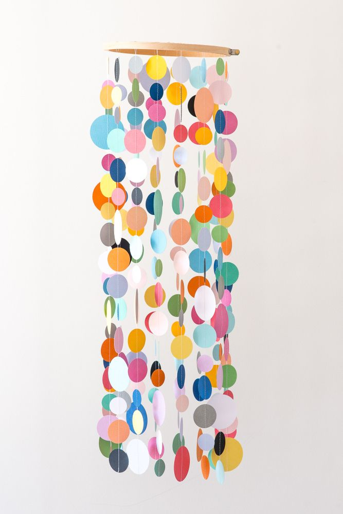 This beautiful mobile will move with the slightest breath, will capture your little ones attention and will last even when all the baby furniture gets moved out to make way for a toddler room. Not just for a bedroom, this mobile is the perfect addition to any playroom or study.  Each mobile is lightweight and is made with approximately 240 hand stamped card stock circles that are strung to a 7 inch wooden hoop. Each strand of circles is tied and also glued to the hoop for added ...
