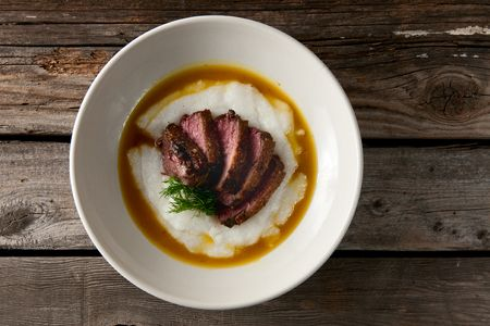 A recipe for seared goose or duck breast served with an orange and ouzo sauce.