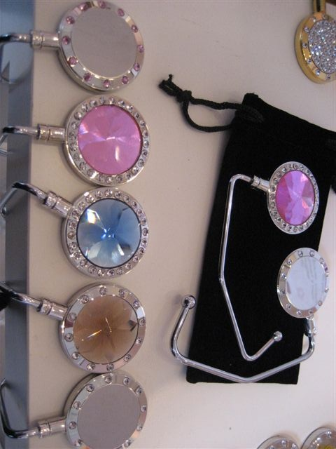 #Purse hooks from Hook-Her on display. We have a great selection of purse hooks at   www.hook-her.net