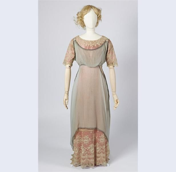 Pink silk gown with lace, Leo Simonis, Amsterdam, ca. 1910-30. Tunic of blue-gray silk crepe, embroidered with Greek motifs.