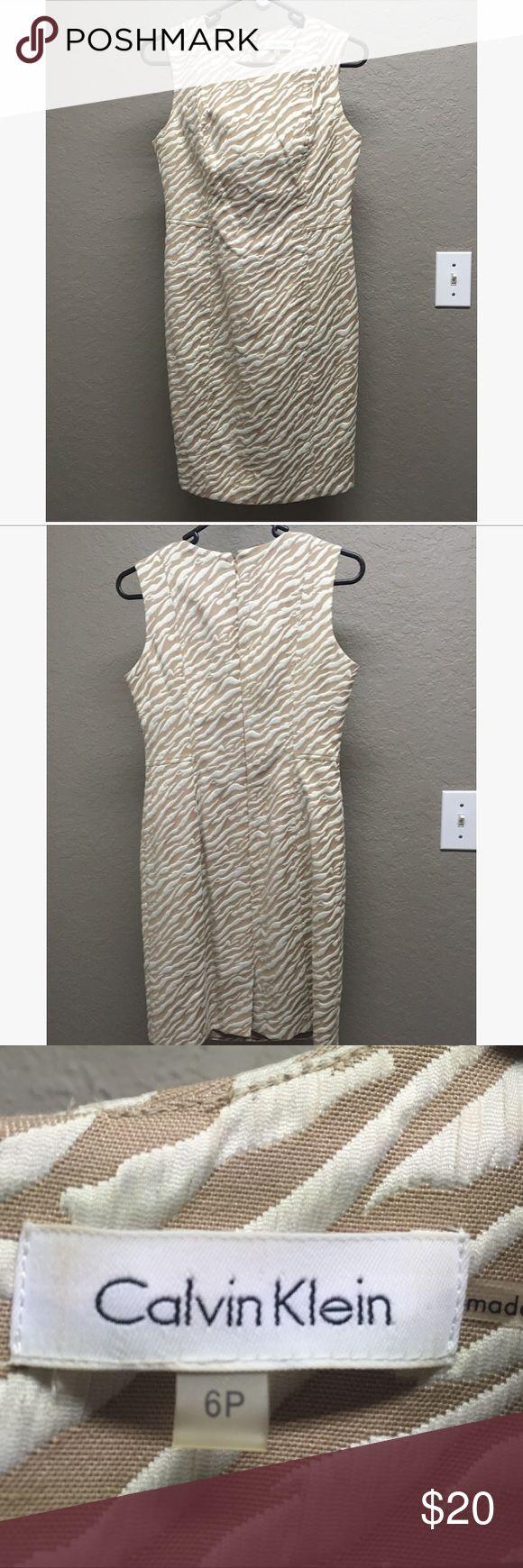 Calvin Klein Dress Animal Stripes Cream Size 6P Worn only a few times! Calvin Klein sleeveless dress in size 6 petite. Cream/tan animal print design. Calvin Klein Dresses Mini