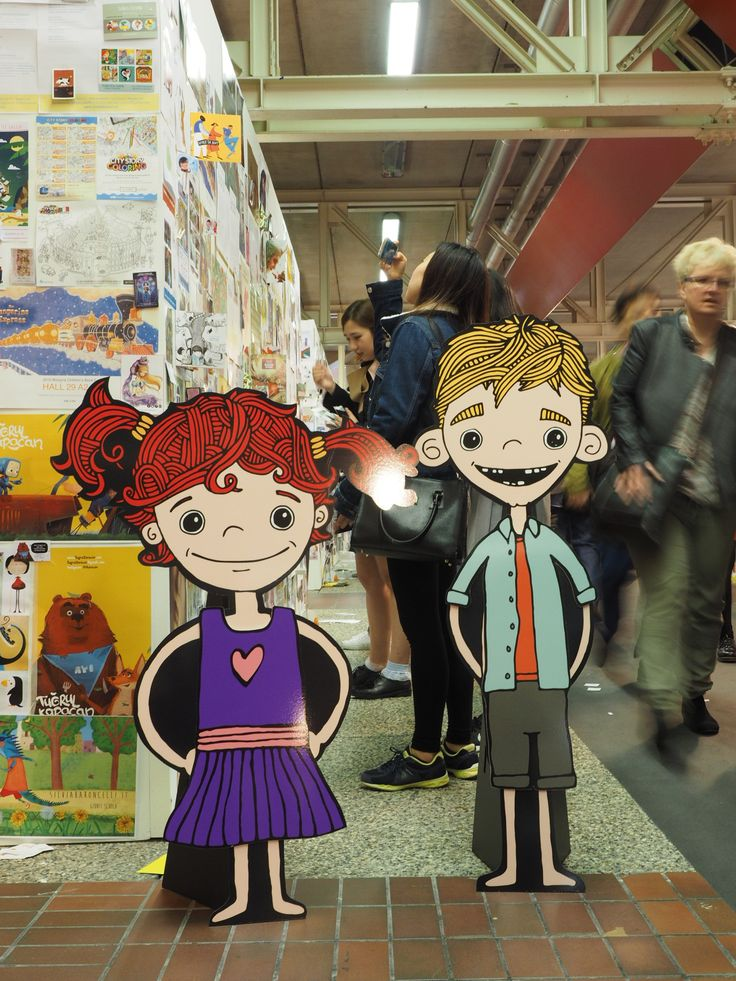 Mimi & Fergus checking out the illustrator's board at the Bologna Children's Book Fair, Italy, day 1