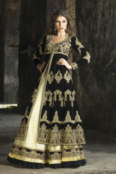 Net ghagra with georgette velvet long jacket, embellished with zari, stone and sequins work.