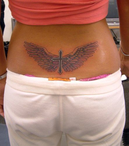 Winged cross tattoo on lower back