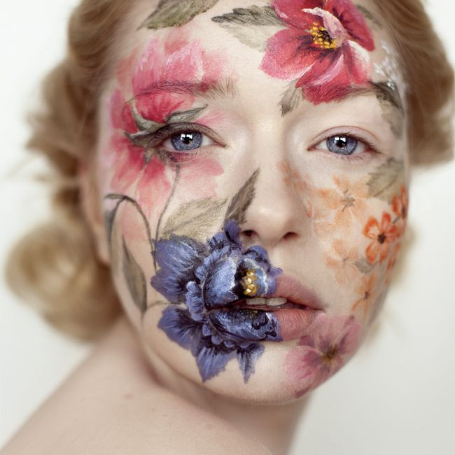 Andrea Hubner  Again on this piece the flowers being painted on to the face before photographing is a different take then just layering them on top in post production.