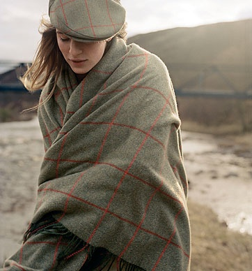 """1999 - Hackett, with an established reputation for its tweeds, launches its most enduring one in conjunction with """"Horse and Hound"""" magazine, a bold and colourful tweed with a green base and red overcheck."""