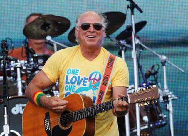 Jimmy Buffett performing on stage