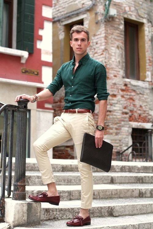 Hunter green is a very traditional masculine color.  Paired with slim khakis and flawless brown accessories, this look is clean and modern.