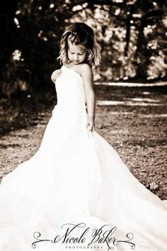 photos of little girls in their mom's wedding dress -