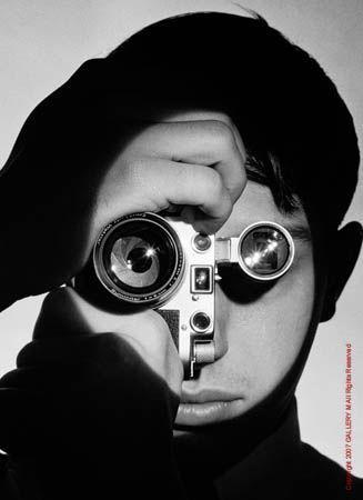 The Photojournalist  1951  Gelatin Silver  by Andreas Feininger  © Time Inc.  Portrait of acclaimed photographer Dennis Stock. Stock won the LIFE Magazine amateur competition in 1951. Feininger took this now iconic photograph of Stock as a result.
