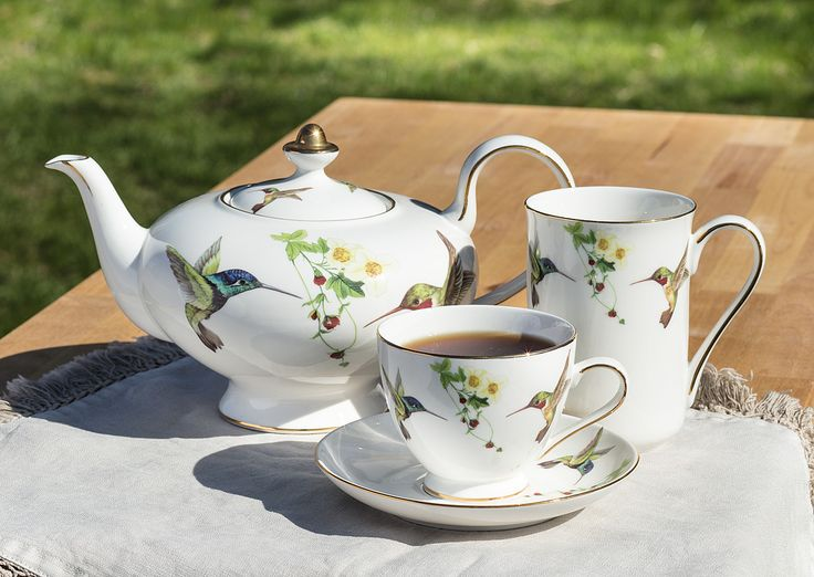 Delicate hummingbirds adorn this lovely tea set! Great for tea party!