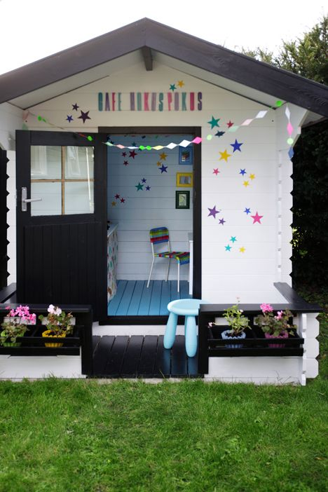 playhouse!  love the black accents and the pretty blue floor