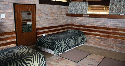 The accommodation used at Berg-en-DalRest Camp for your tour with Tydon Safaris will be in air-conditioned ensuite (shower only) chalets that are situated in tranquil surroundings within the camp.