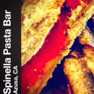 Sun Dried Tomato & Mozzarella Panino on 7 Grain Baguette with Roasted Peppers and Pesto Spread.