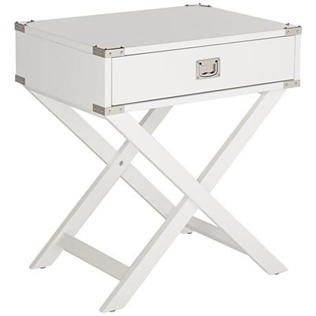 With a small pull-out drawer for small items or remotes, this white accent table is perfect for placement next to a couch or sofa.