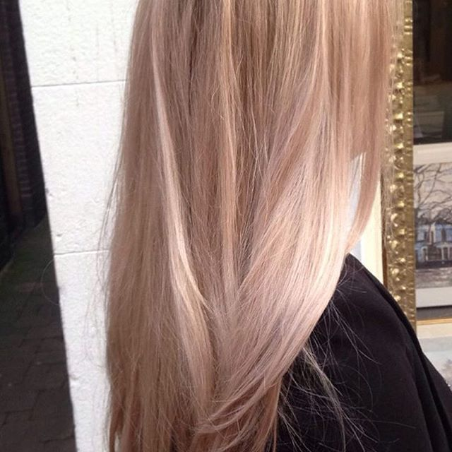 Beige champagne blonde with a hint of pink.