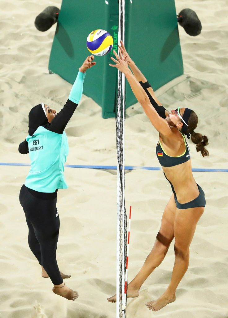 Doaa Elghobashy, left, of Egypt and Kira Walkenhorst of Germany compete in the women's preliminary beach volleyball during the Olympics in Rio. Credit Lucy Nicholson/Reuters