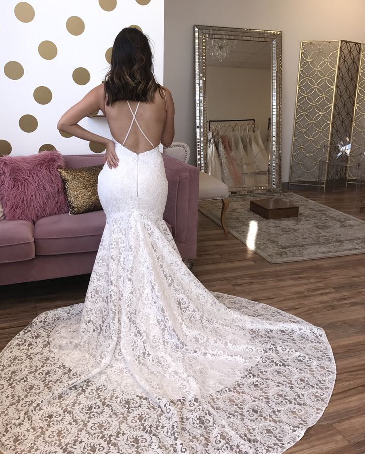"""Criss cross, low backs and long trains... That's what we live for! 💗 SPOILER: This gorgeous Mikaella Bridal designer gown will be part of our huge sample gown sale event! There is only ONE and it's marked down significantly...which means """"first come, first served""""! 🙊  Reserve your appointment via link in our bio! www.azbridestudio.com"""