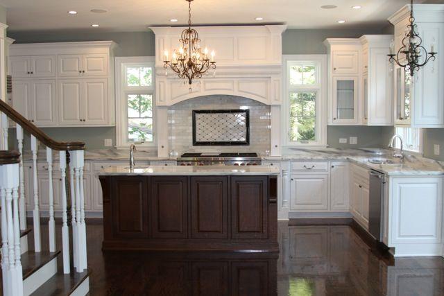white kitchen, brown island, dark floors, paint