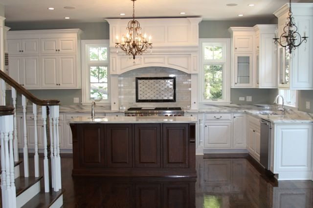 white kitchen brown island dark floors paint the