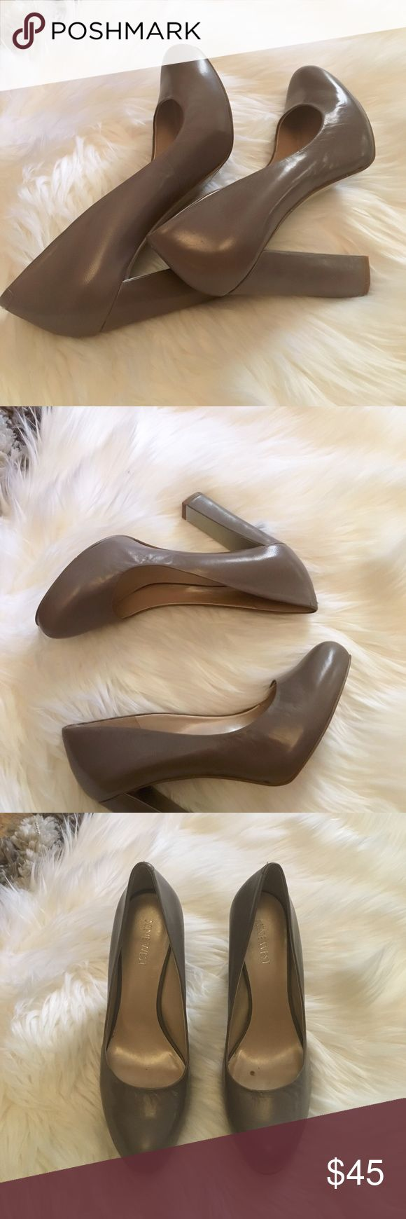 Nine West pumps Beautiful gray Nine West heels. Has a silver metal on the inner heels Nine West Shoes Heels