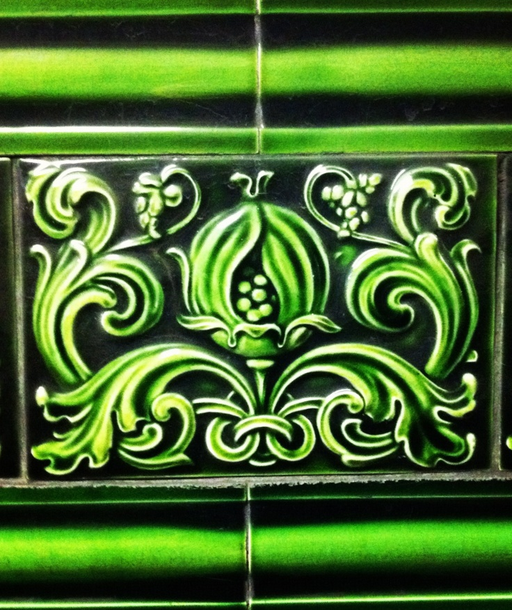 """Underground tiles: Leeds Fireclay Co Ltd? """"Ticket halls featured deep-green tiling with a stylised acanthus leaf or pomegranate frieze."""""""