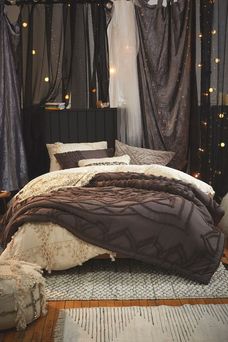No headboard? No problem! Hang some curtains and throw in some some lights for added ambiance!