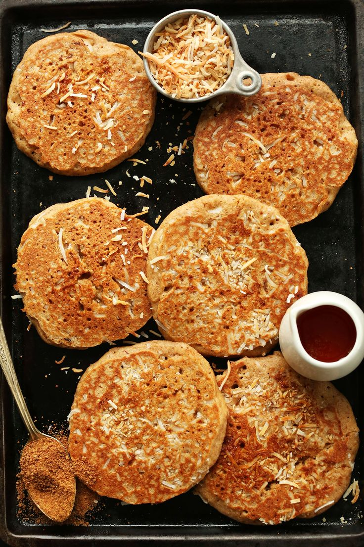 THE BEST VEGAN Toasted Coconut Pancakes aka Better Than Sex PANCAKES! So delicious, fluffy, and coconutty. #vegan #breakfast #pancakes #recipe