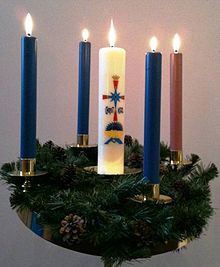 Advent Wreath; typically we use The Paschal Unity Candle in the Middle, with 3 purple and one pink (pink is the 3rd week) for Our Advent Wreath, however, this is fine too.. What ever candles one has is sufficient, it is the meaning of Advent that is most important...