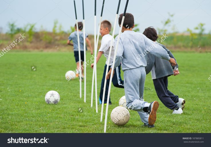 stock-photo-boy-playing-with-a-ball-on-the-soccer-field-187885811.jpg (1500×1049)