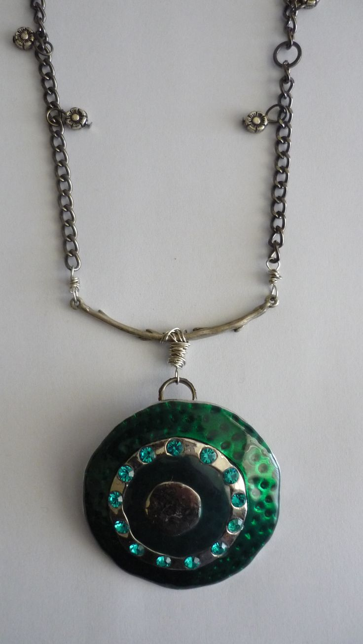 Amanda Harris Large green round pendent with green stones on silver bar on nickel chain with charms