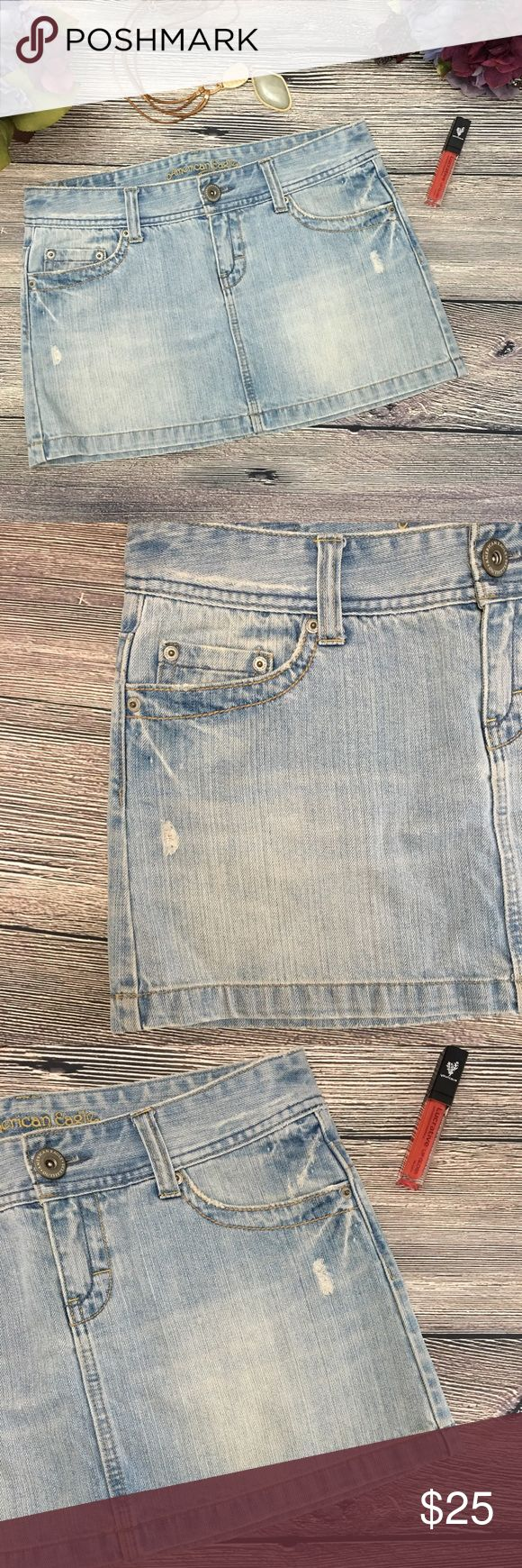 """AEO Distressed light wash denim mini skirt so 8 Meet Macie. From American Eagle Outfitters, shes distressed denim to perfection. A light blue with factory distressing that instantly makes her look like she's been your favorite forever. Traditional 5 pocket styling, AEO stamp on front button/zip fly closure. 100% cotton. Approx. 16.25"""" waist, 13"""" length waist to hem in back, closer to 12"""" length in front (extra inch in back to cover your behind). Measurements taken when laid flat and not…"""
