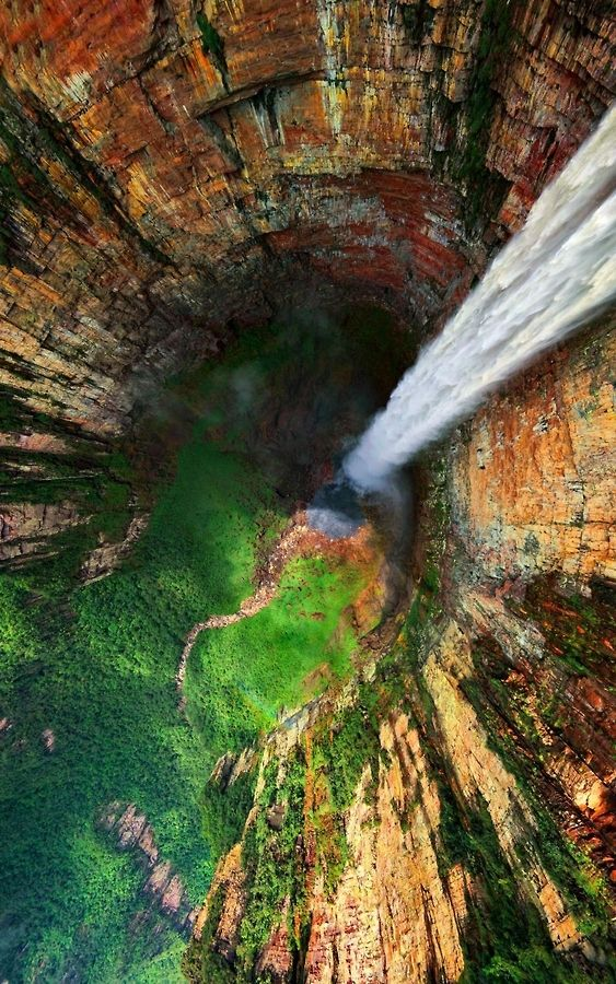 Angel Falls (Salto Ángel) in Venezuela is the world's highest uninterrupted waterfall, with a height of 979 m (3,212 ft) and a plunge of 807 m (2,648 ft). The waterfall drops over the edge of the Auyantepui mountain in the Canaima National Park.