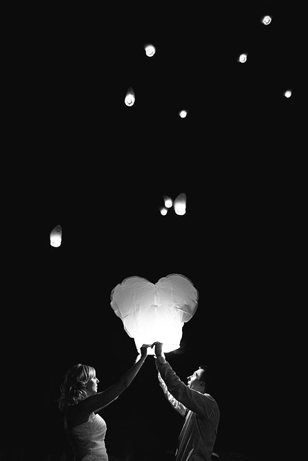 What a lovely photo of the newlyweds releasing a heart-shaped sky lantern into the night sky!