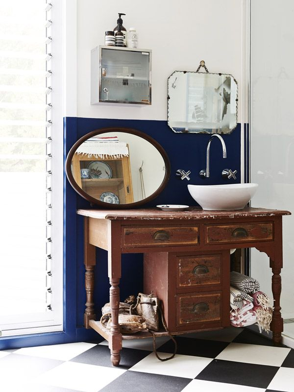 Love the vintage accents in this bathroom.