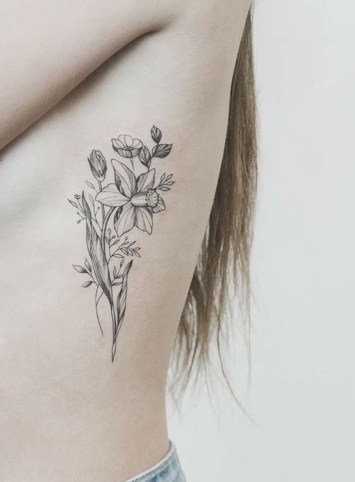 Daffodil for Ashley tattooed by Tritoan Ly , Seventh Day Studio