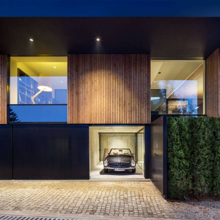 The Car's the Star in This Modern Home in Bulgaria - http://freshome.com/cars-the-star-modern-home-bulgaria/