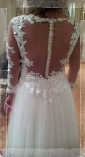Eleni Kollarou / Wedding dress with a beautiful open back