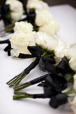 Simple bridesmaids bouquets since their dresses are bling . Gold ribbon